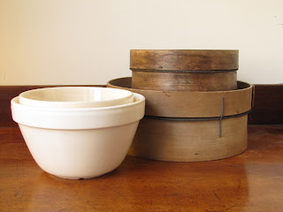 T.G. Green and Mason Cash pudding bowls or pudding basins stacked together with a vintage wooden sieve