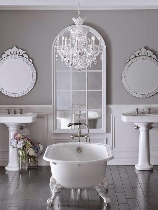 white bathroom with chandelier light bathroom lighting scheme