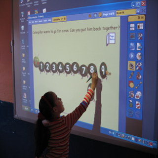 Young Girl on Smartboard