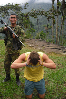 A mock photo of our blogger being held at gunpoint by a willing Colombian soldier at La Ciudad Perdida