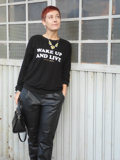 Wake Up And Live. An edgy, slightly rock, but fairly casual look with graphic sweatshirt and faux leather pants || Funky Jungle - Mindful Fashion & Personal Style Blog