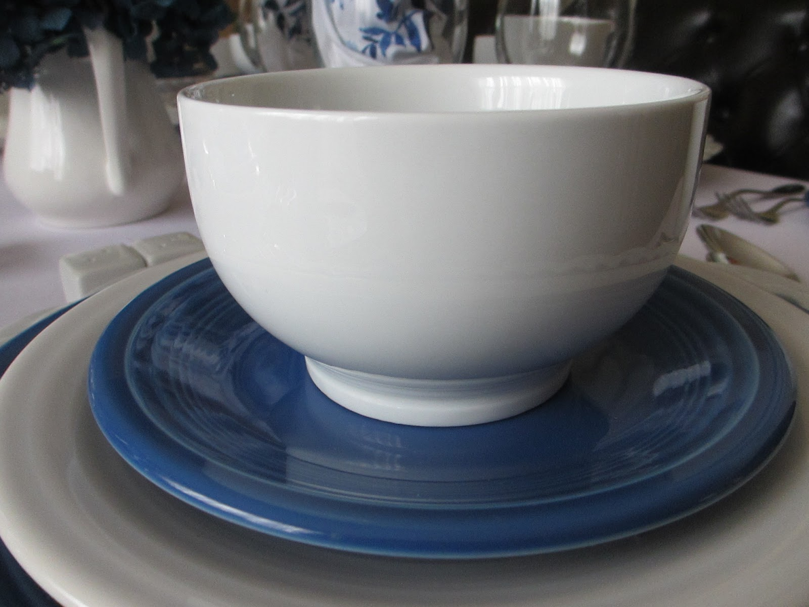 The Welcomed Guest Lapis And White Fiesta Dinnerware Table