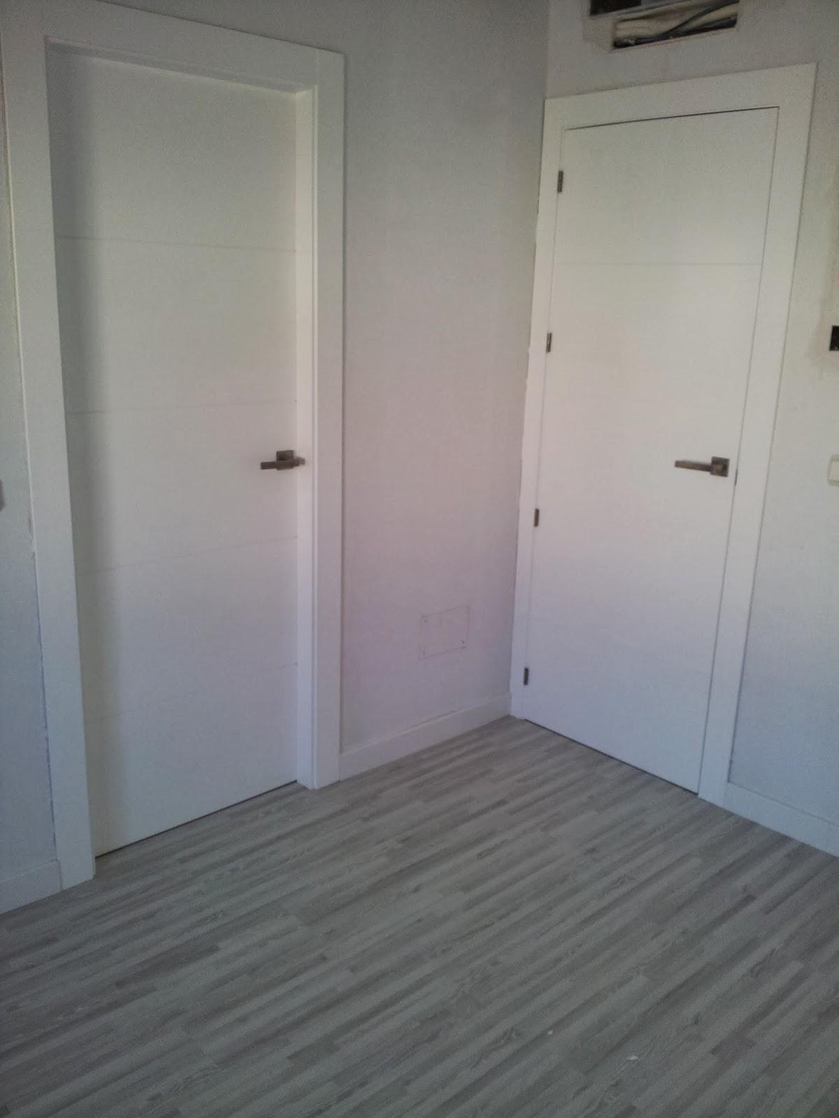 Pjmc trabajos carpinteria puertas de paso blancas for Suelo gris y puertas blancas