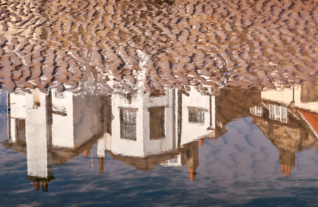 Robins Hood's Bay house reflected in a pool of water by Martyn Ferry Photography