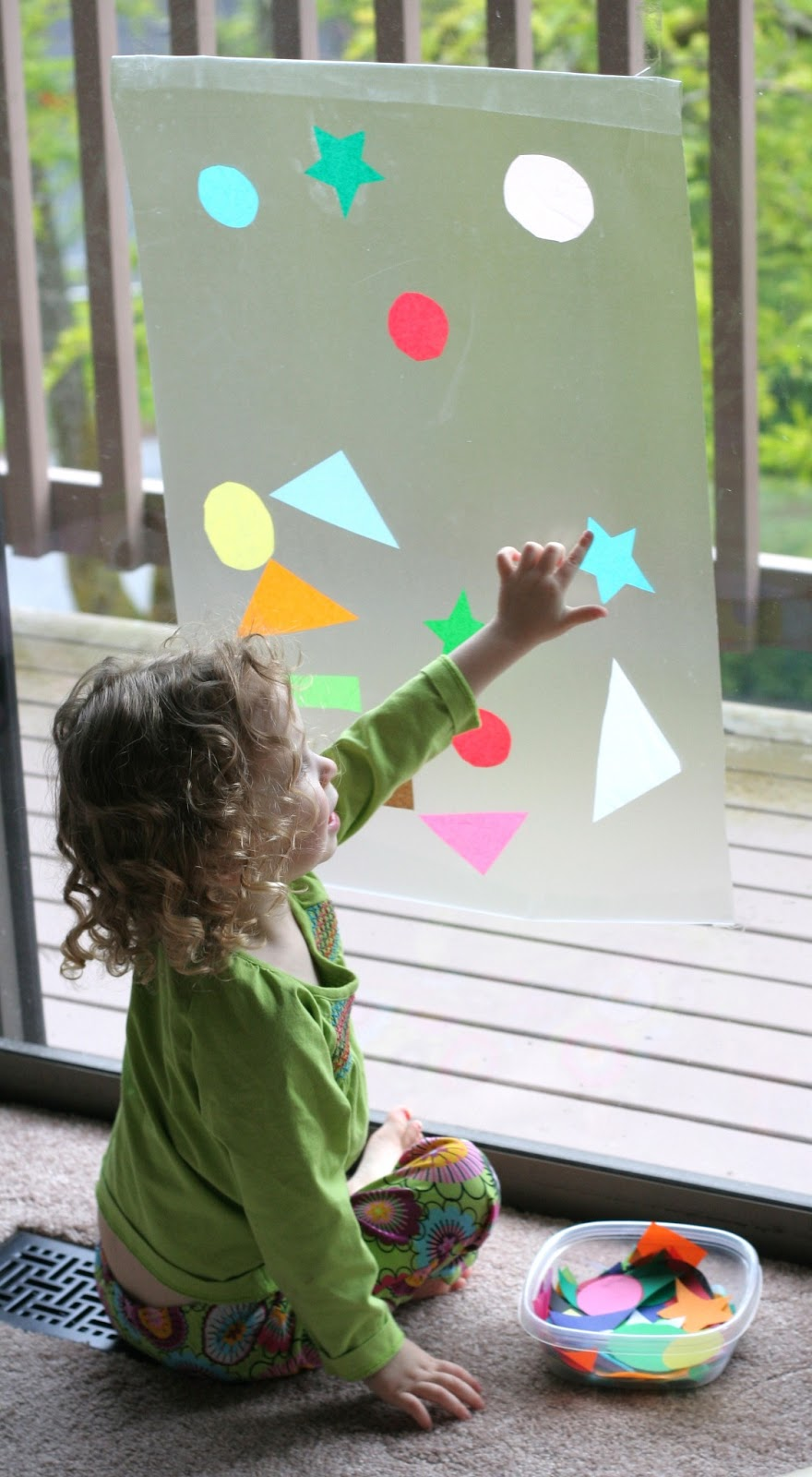 Contact paper window art for Cardboard activities for toddlers