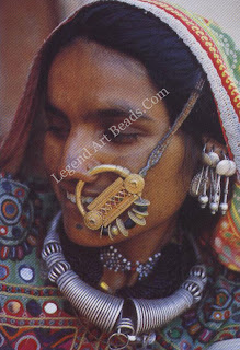 Meghwal woman from Banni, Kutch, wearing the varlo and the velado (silver wire necklace and gold nose ring). Note the silver earrings that cascade from the upper ear.