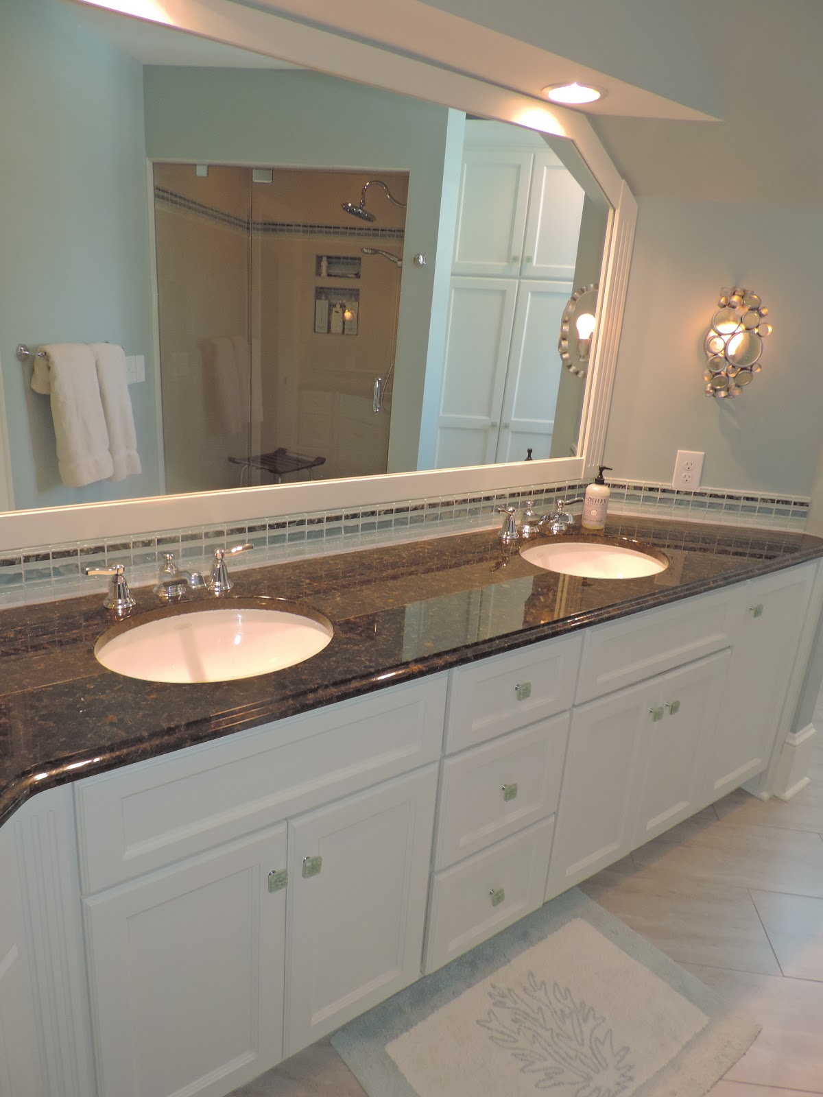 Cool These double vanities are accented with glass tiles