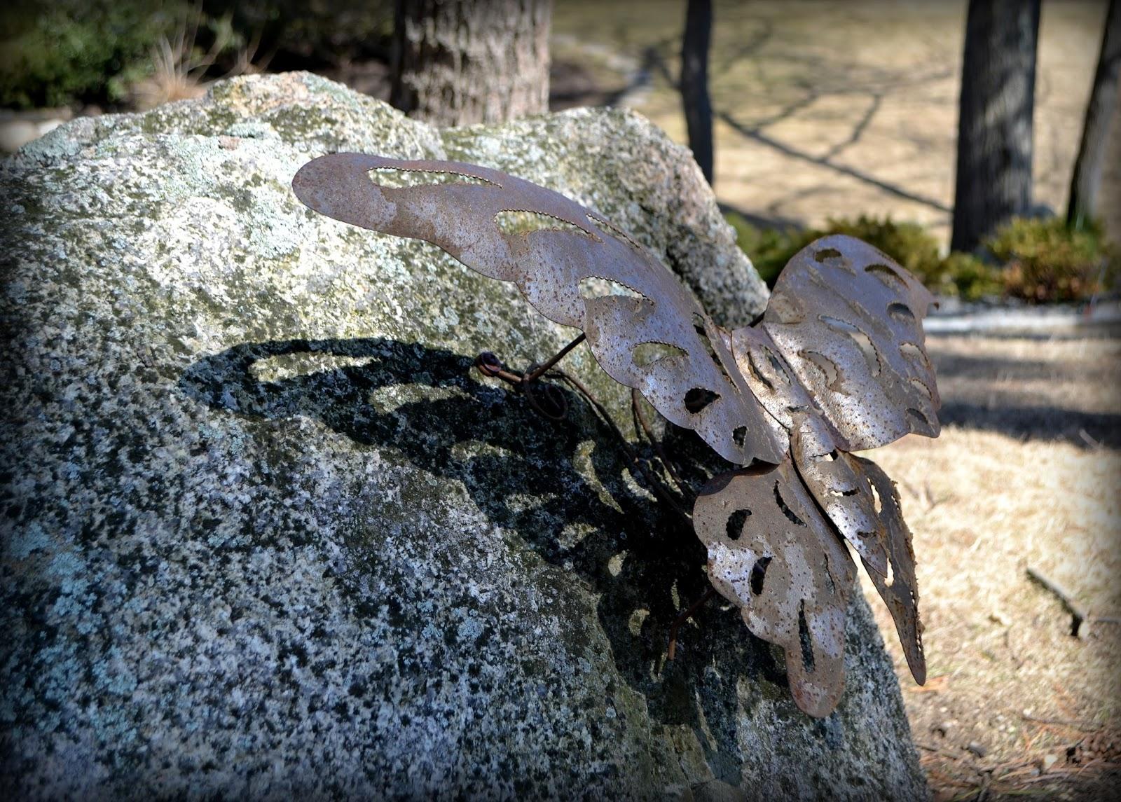 bronze, butterfly, stone, boulder, garden, hospital