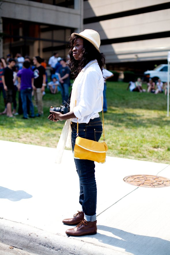 Hat yellow bag jeans and brown boots, girl holding camera street style, southern street style, virignia fashion