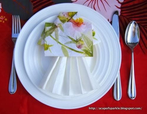 http://acupofsparkle.blogspot.com/2011/08/lets-hula-hawaii-hula-girl-napkin-fold.html