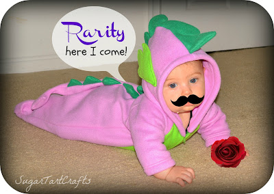 "Baby in a Spike costume with a photo-shopped mustache saying ""Rarity here I come"""