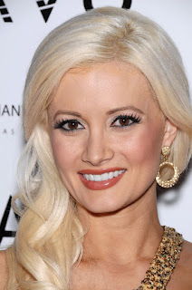 Holly Madison ready to party in Vegas in a dairingly short mini dress.