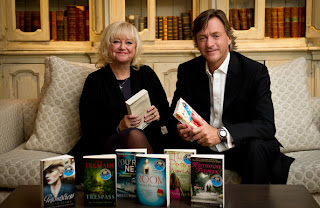 Richard and Judy on a sofa