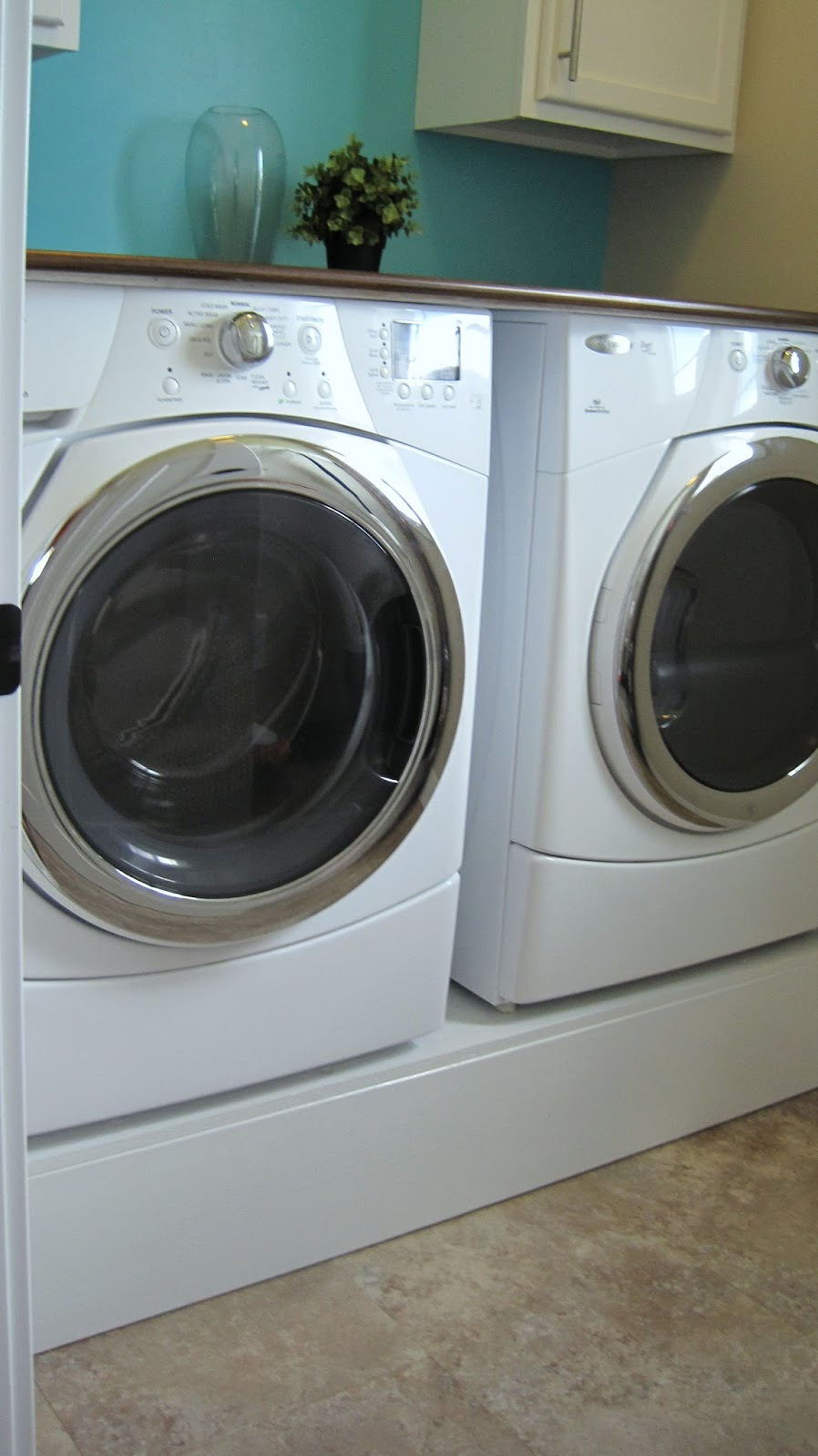 Blank And White With Aqua Laundry Room