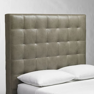 http://www.westelm.com/products/tall-grid-tufted-leather-headboard-g390/?pkey=cheadboards-bed-frames&cm_src=headboards-bed-frames||NoFacet-_-NoFacet-_--_-