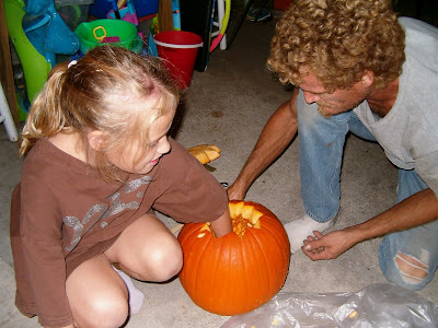 Daddy and Rachel carving pumpkin 2012