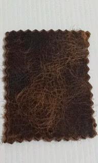 Kulit sintetis yang di gunakan untuk menggosok batu akik