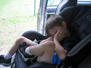toddler boy sleeping in car seat in summer