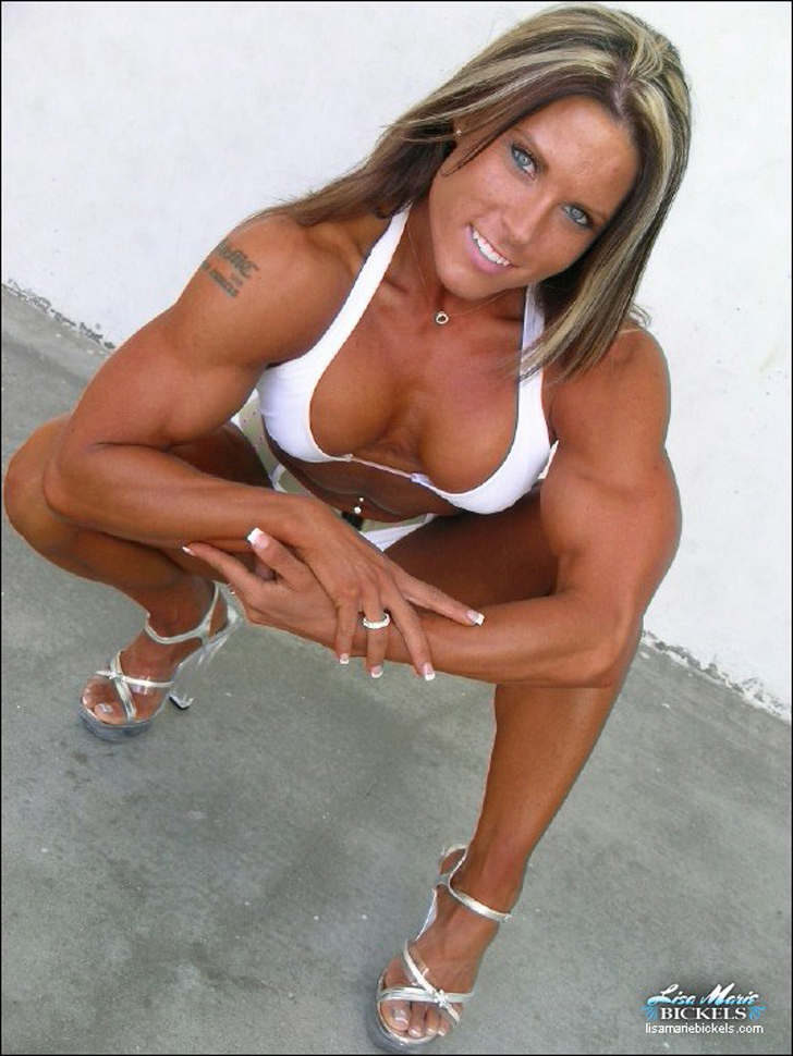 Lisa Bickels Models Her Buff Biceps And Fit Physique In A Bikini