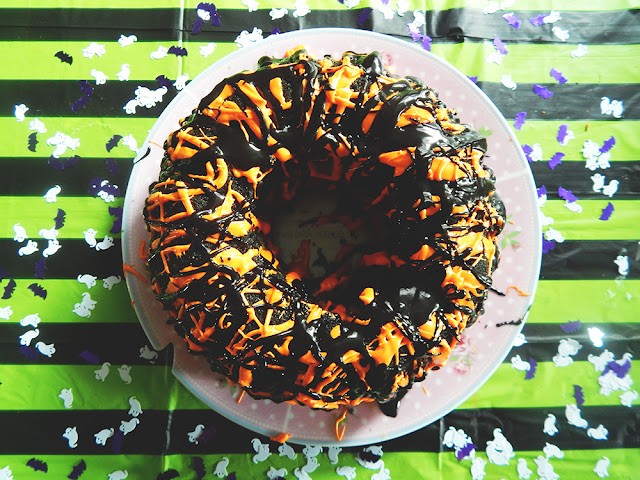 Black and orange frosting drizzled over a bundt cake