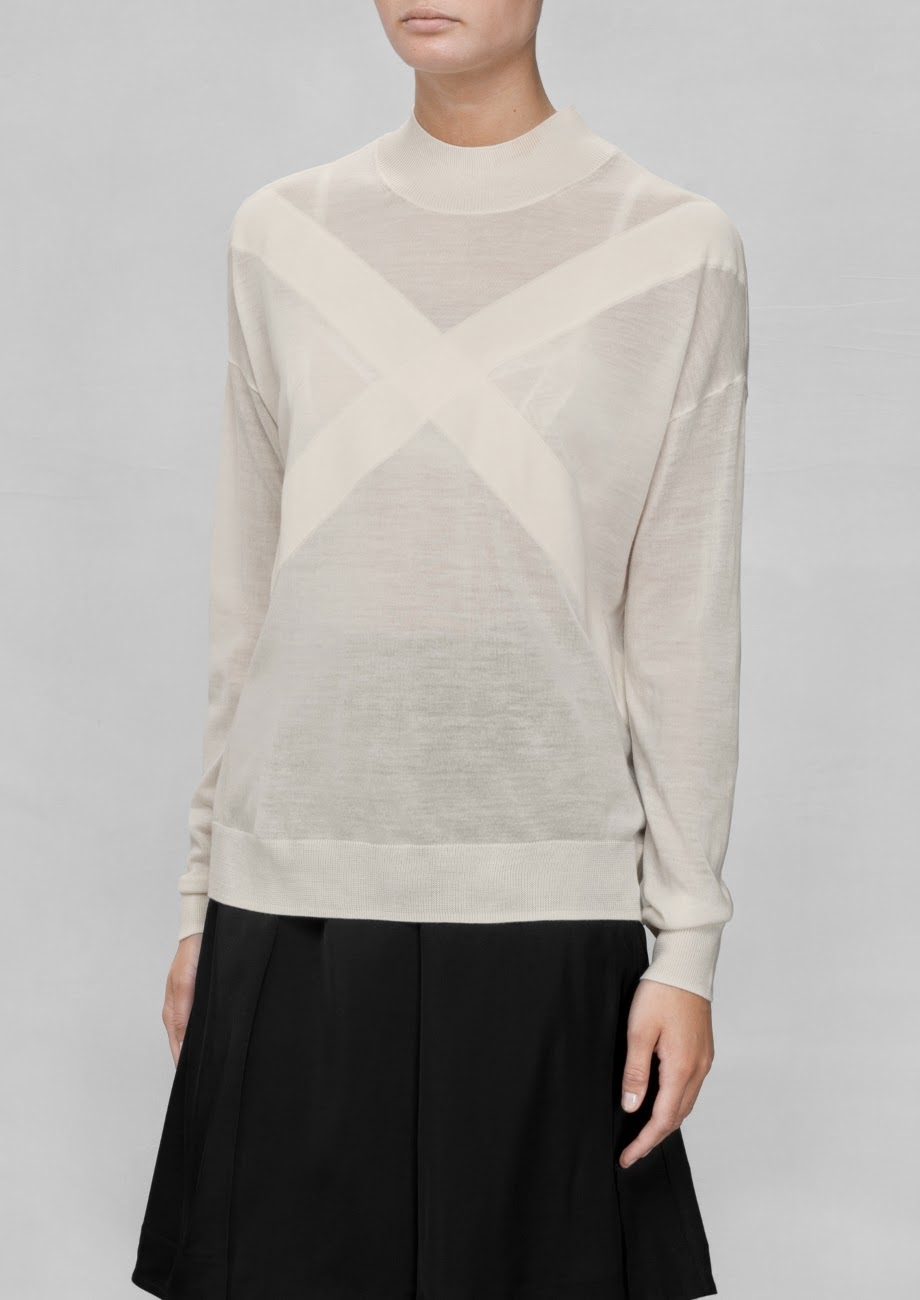 cream cross jumper