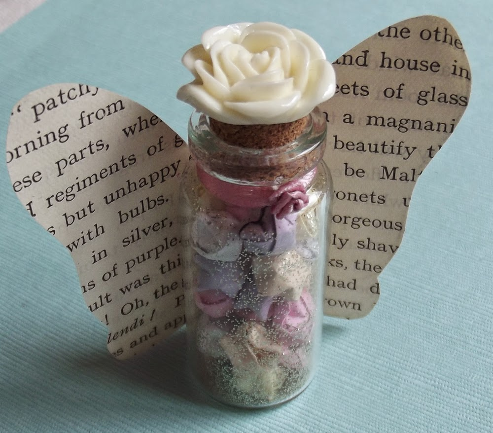 glass vial wishing lucky origami stars quilling paper gold glitter resin rose ribbon rose book page fairy butterfly wings