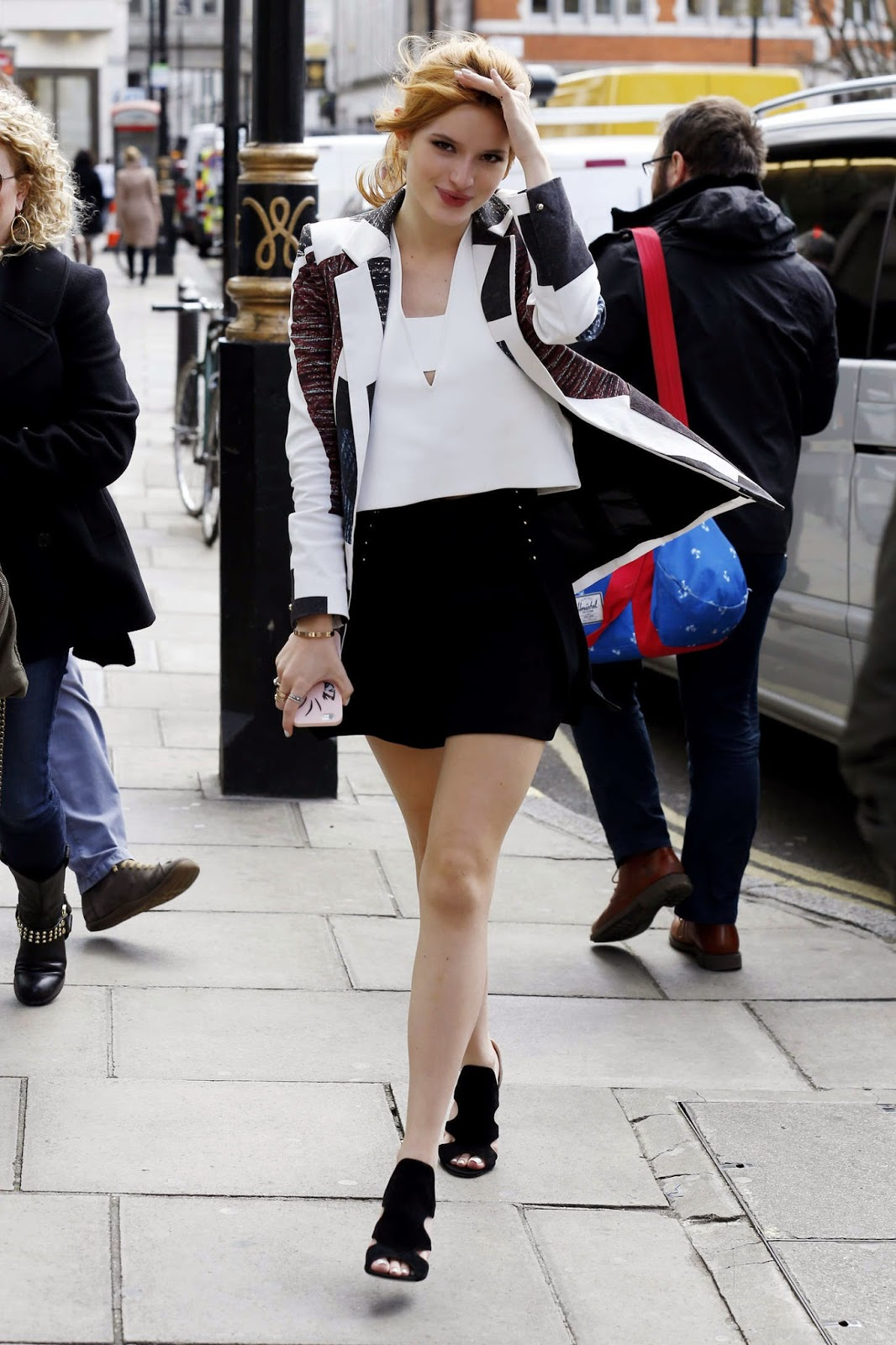 Bella Thorne in a short skirt out and about in London