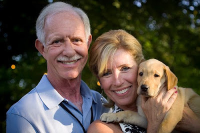 Sully and Lorrie Sullenberger with yellow Lab pup