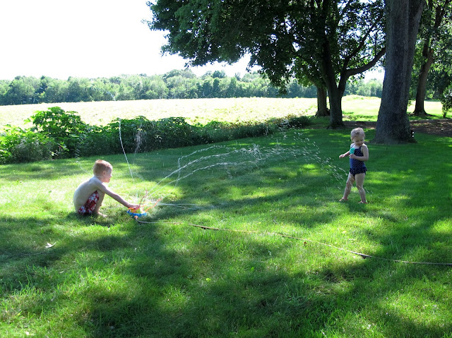 Spraying Stella with the Sprinkler Hoses