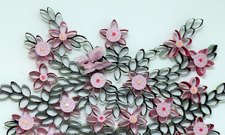 Recycling paper flowers made of tiolet paper rolls on the wall think twice before you pull that last square of toilet paper off the roll then throw that roll in the trash you could be throwing away magic mightylinksfo