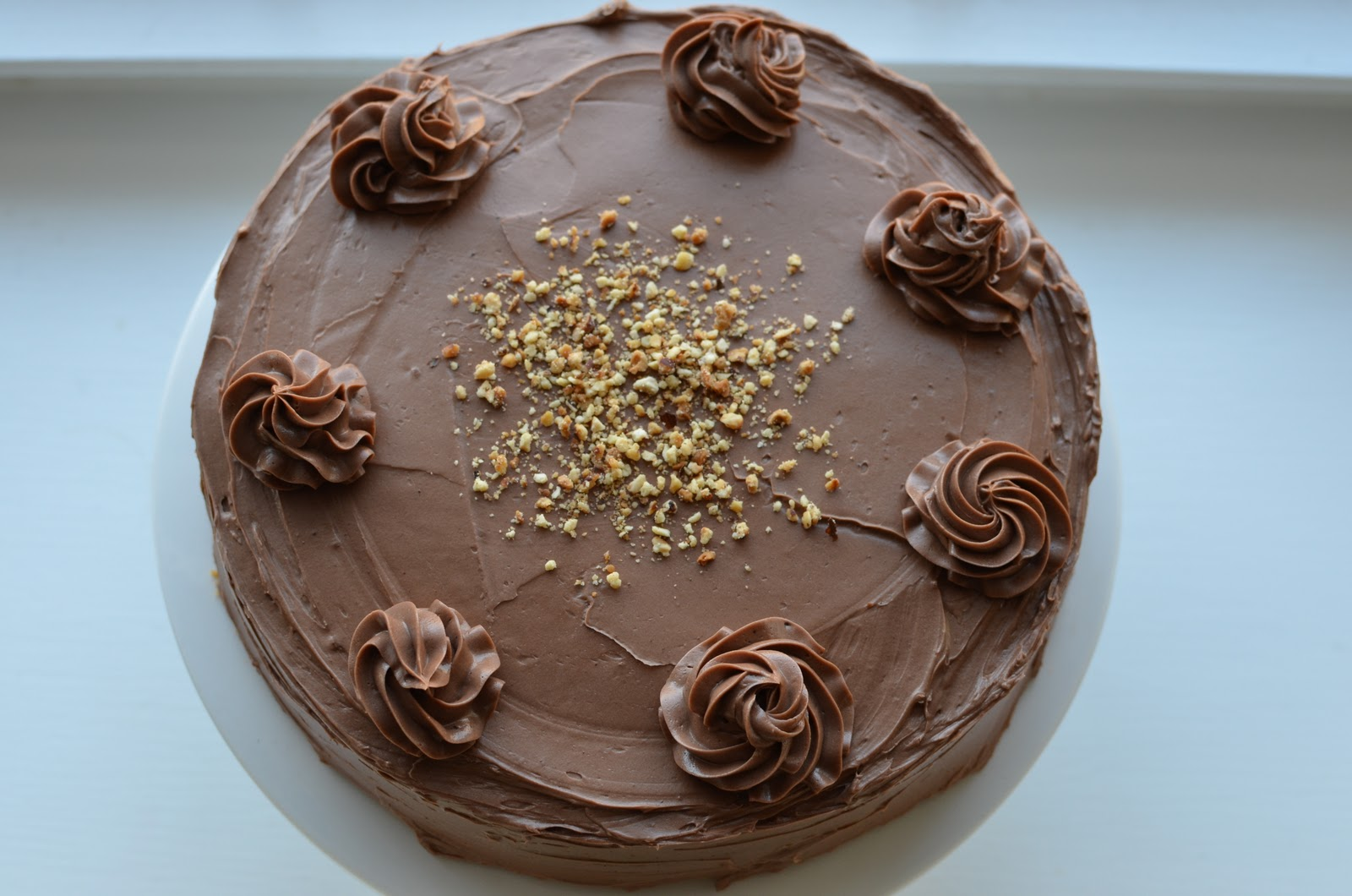 ... Hazelnut cake with praline and milk chocolate buttercream - 100th Post