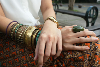 Gold bangles and watch
