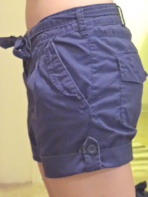 dark blue shorts with waist tie and pocket flaps, from salvation army vancouver