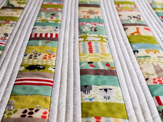 Close view of custom organic cotton baby quilt by Organic Quilt Company