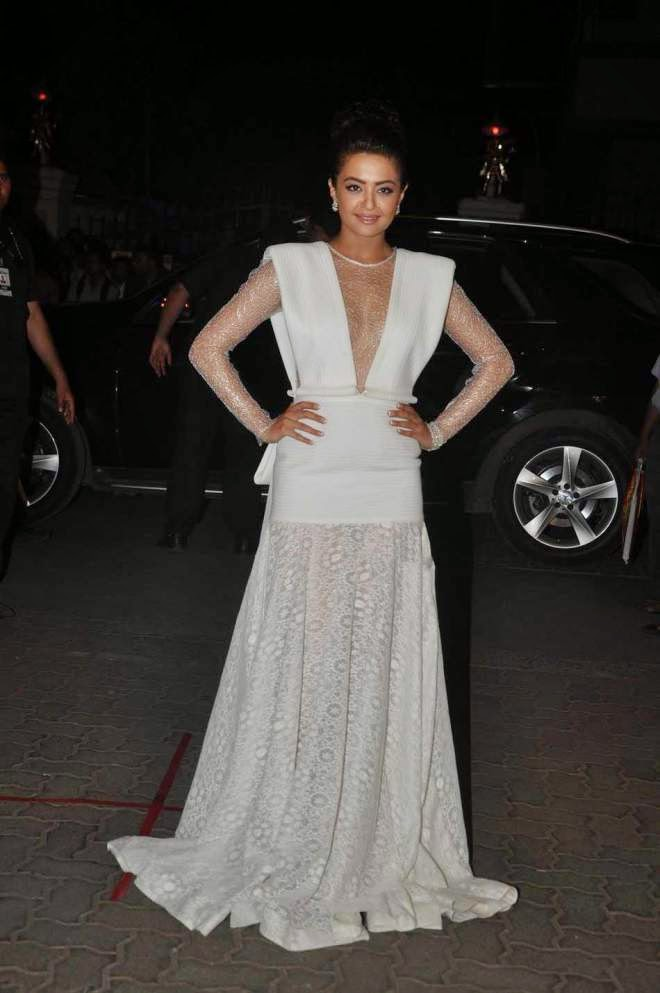 Surveen Chawla Hot V Neck White Gown Wallpapers