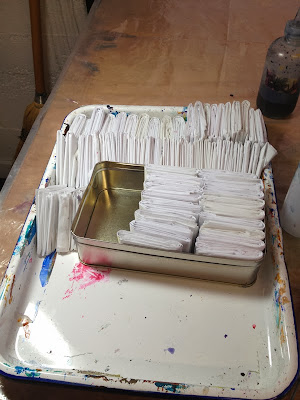 Tray of folded papers