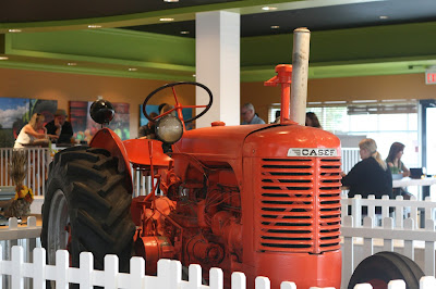 Big red tractor at the front door of P&H.