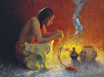 A Native American croodling by a campfire