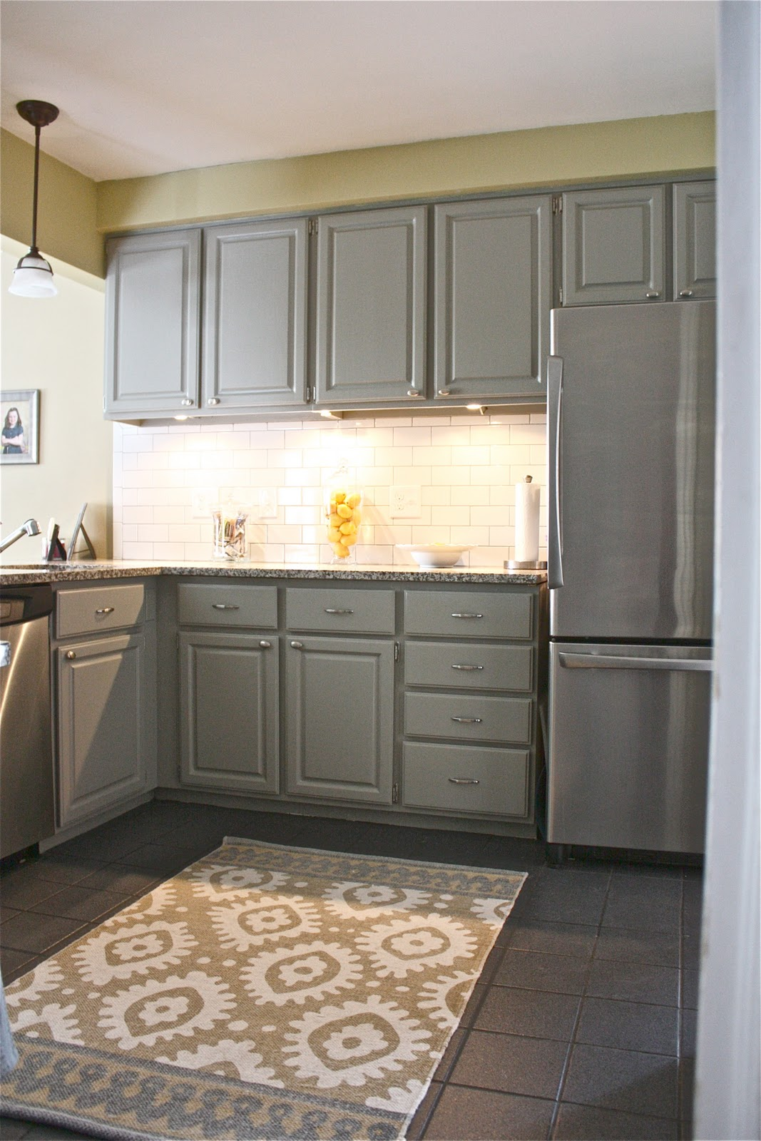 The yellow cape cod client project kitchen before and after for Grey kitchen paint ideas