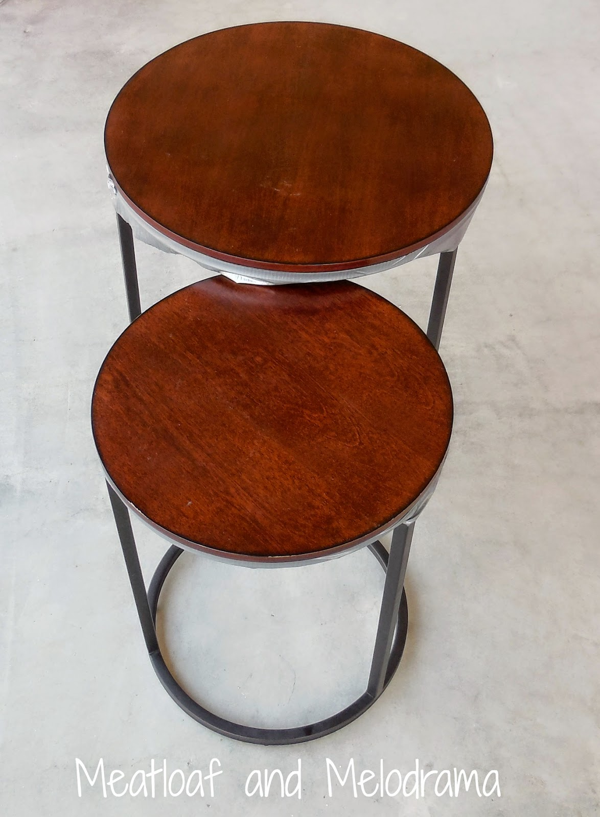 two industrial style laminate brown nesting tables