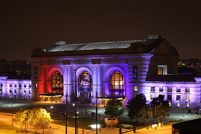 Image of Union Station lit in multiple colors at night