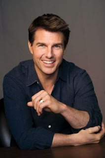 'Oblivion' star Tom Cruise signs his fans' breasts