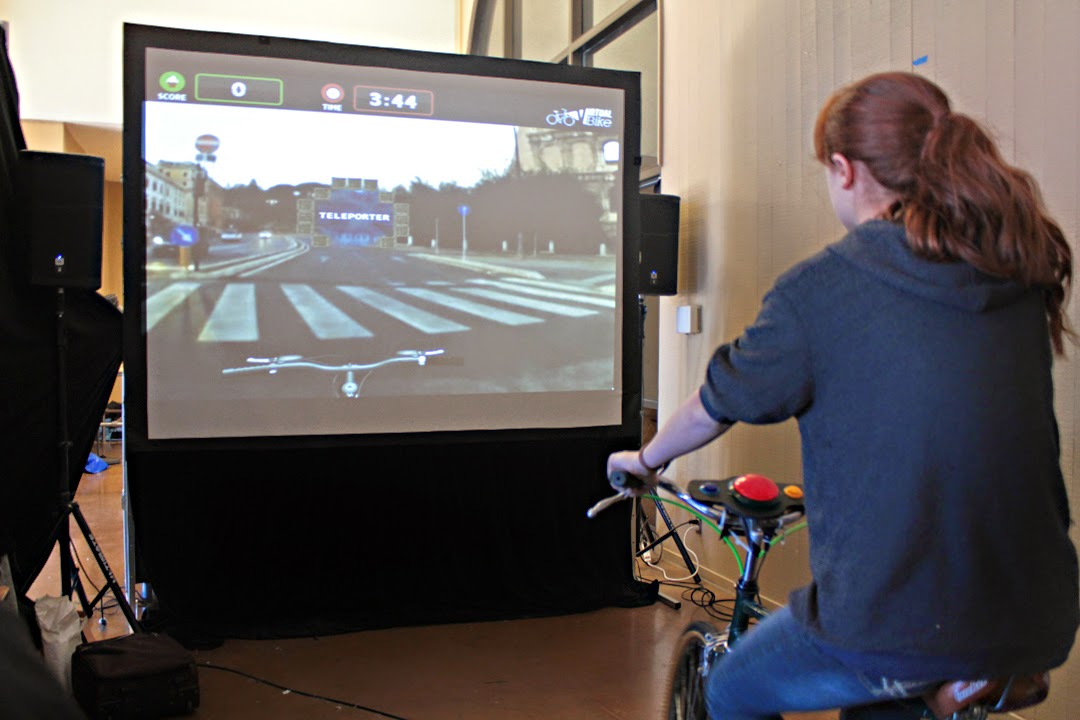 Attendee rides a bike on a virtual tour of Rome