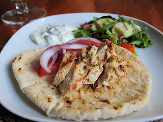 Chicken Gyro on pita with tomatoes, red onion, salad and tzatziki sauce