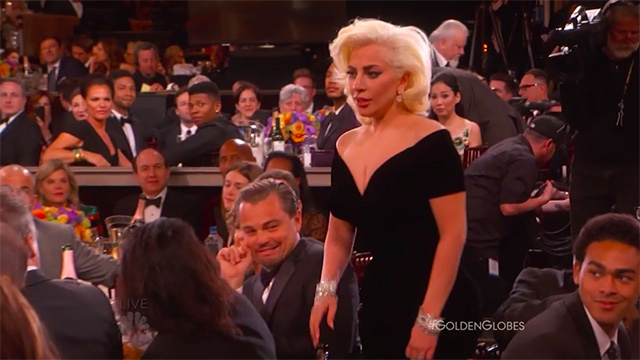 Leonardo dicaprio's face when lady gaga barged past him was superb