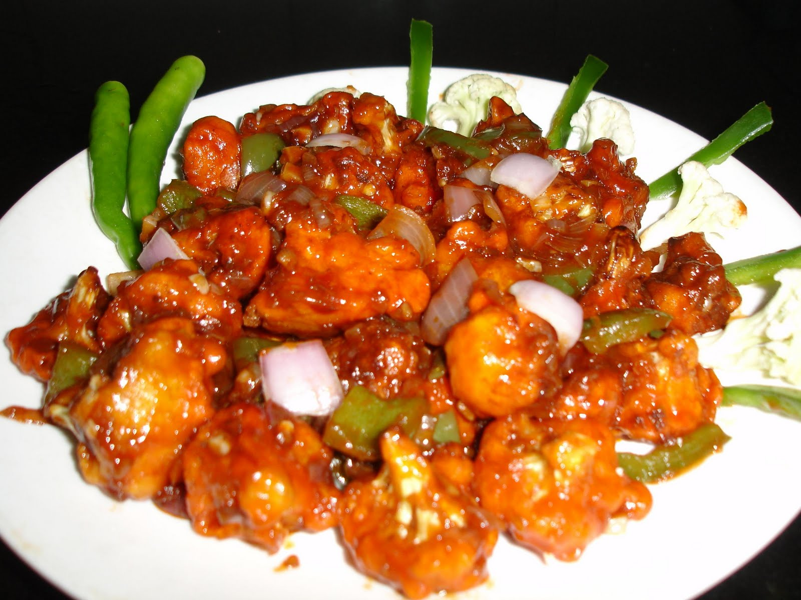 gobi cooking and red chili sauce Gobi aloo (indian style cauliflower with potatoes) some did things to make a sauce/gravy this is a very basic version of the traditional aloo gobi recipe.