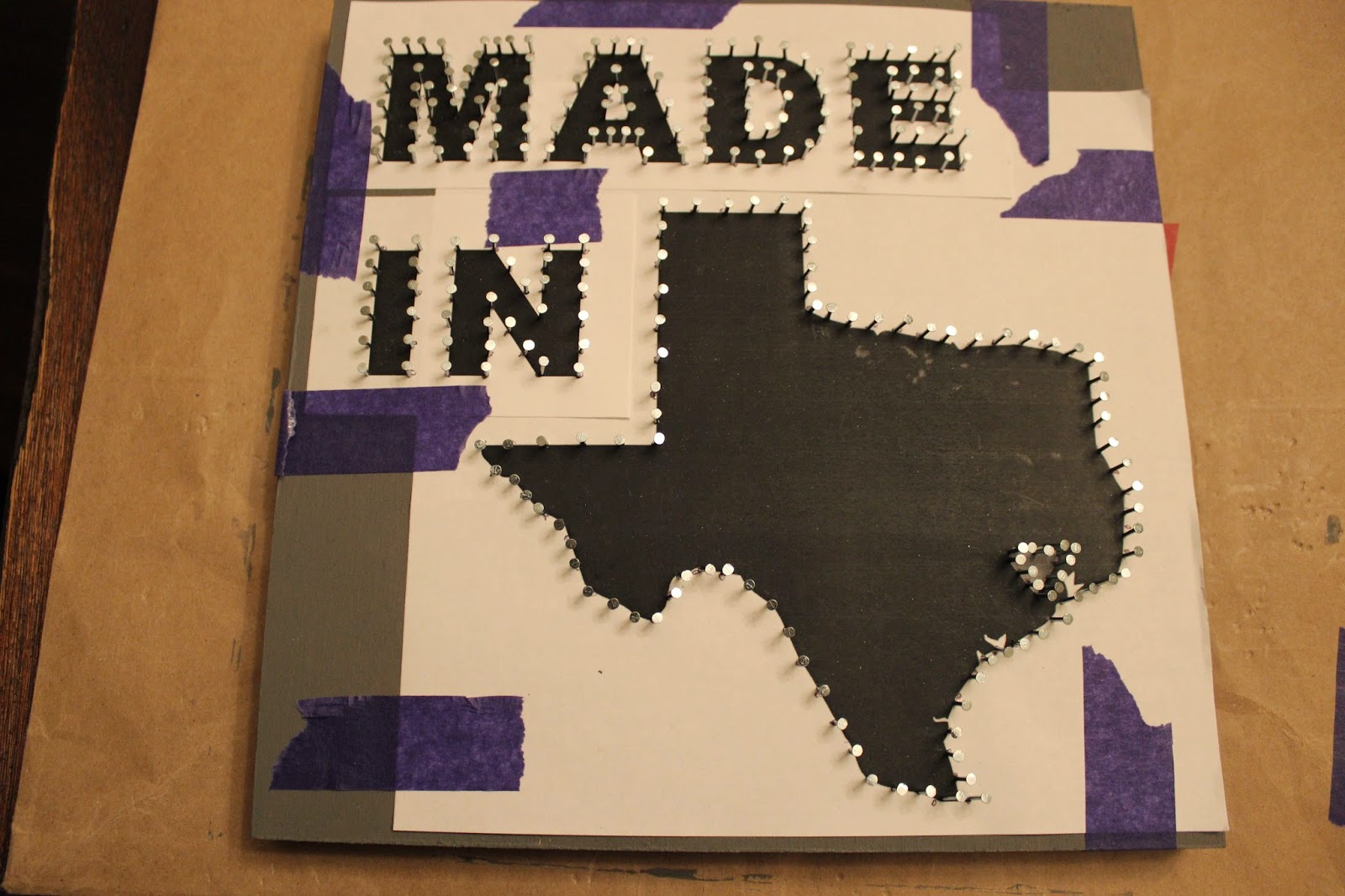 Domesticated diva baby matthews nursery decor made in texas 4 hammer in the nails to the wood panel this is the longest step in making your string art leave at least a 14 of the nail protruding out prinsesfo Image collections