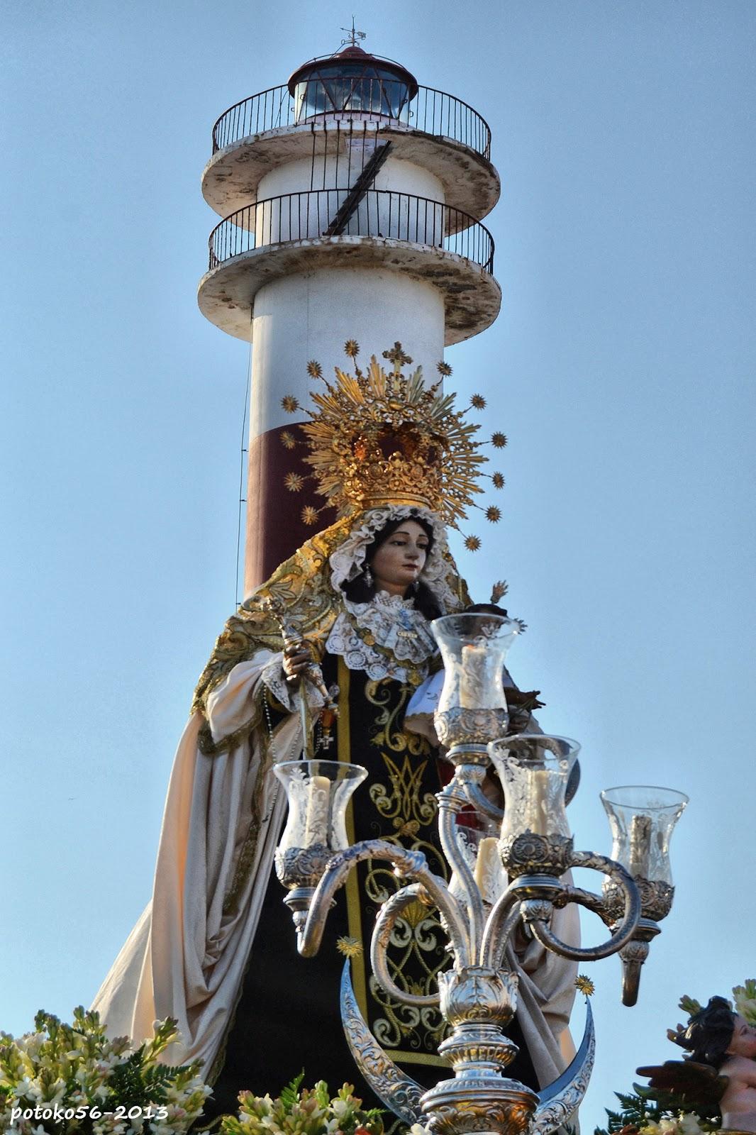 La virgen del Carmen y el Faro Rota