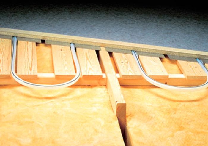хотим положить теплый пол (водяной) на деревянный в своем доме (не квартира, дом) . согреет ли? у кого есть...