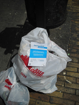 Out with the old, in with the new. An Acueducto leaflet looking for workers sits on top of a rubbish bag from one of the current providers